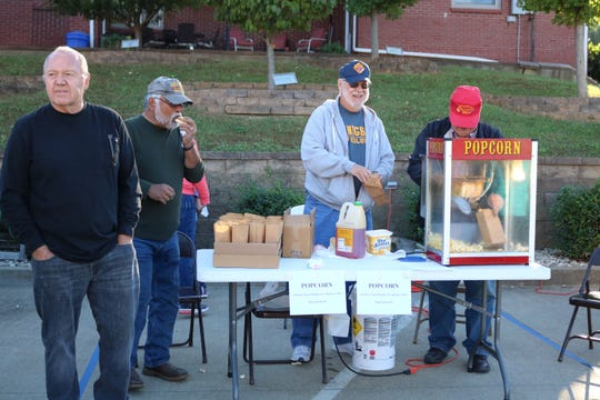The Morganfield Knights of Columbus serve popcorn during the fall event.