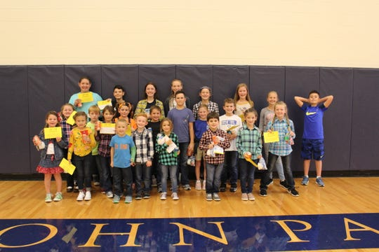 Several John Paul II Catholic School students were 'Caught Being Kind' to others during the month of September.  Recognition of all students were held in Knights Gym where the student and their good deed is recognized.  All students are rewarded with a Caught Being Kind treat bag and a soda.