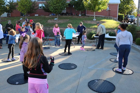 Students enjoy a cake walk at the event.