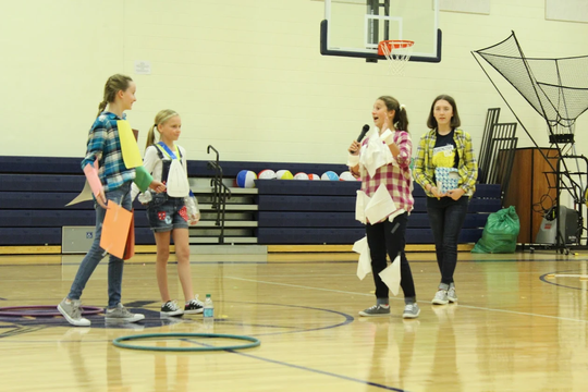 John Paul II Catholic School Beta Club members performed a Recycling Skit during an assembly for the students.  Beta Club members Paige Steward, Lauren Lovell, Drew Ann Sprague, and Madison Morris share tips with the students to recycle properly.
