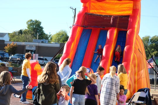 Youth enjoyed the bouncy house while at the family event at the library.