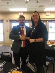 Judge Executive Adam O'Nan presents a check to Habitat for Humanity representative, Kristin Baird.