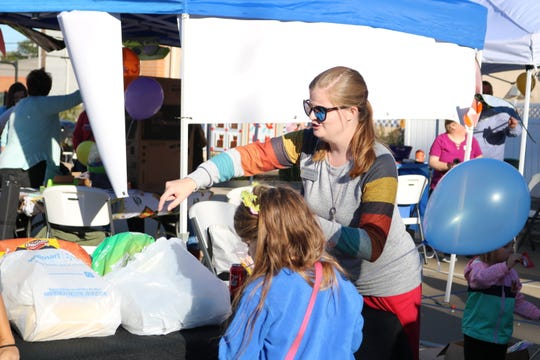 Sara Lyon, representing Breckinridge Services, talks to a student at the festival.