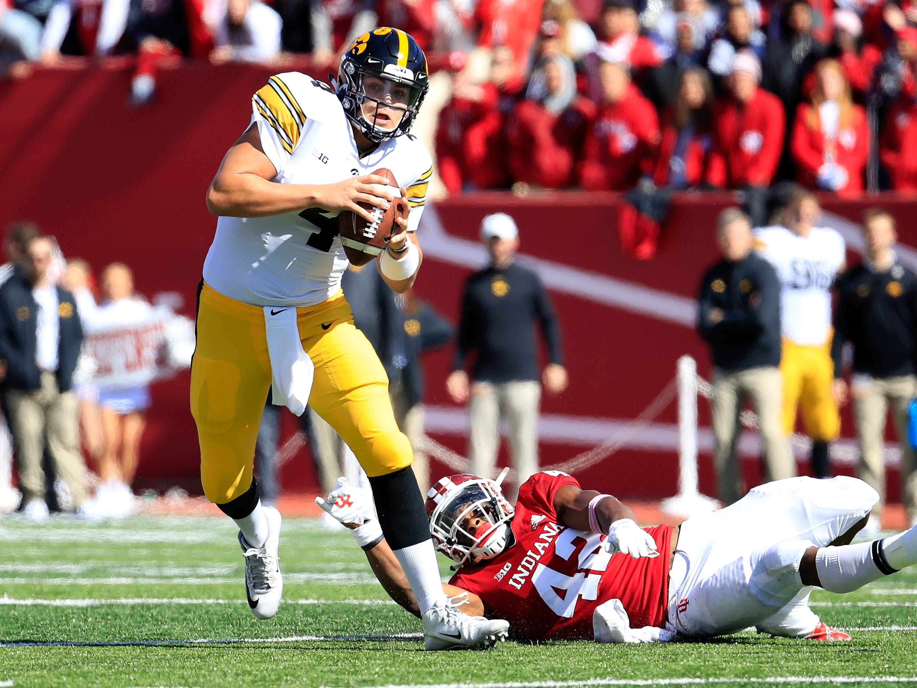 Nate Stanley scrambles on his way to throwing a spectacular touchdown pass to Nick Easley during Saturday's 42-16 win at Indiana.