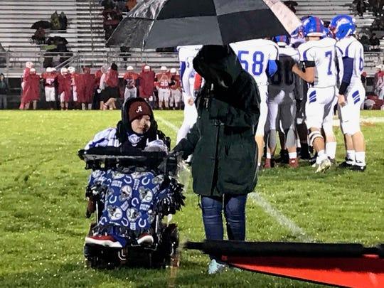 Hunter Schafer in wheelchair.