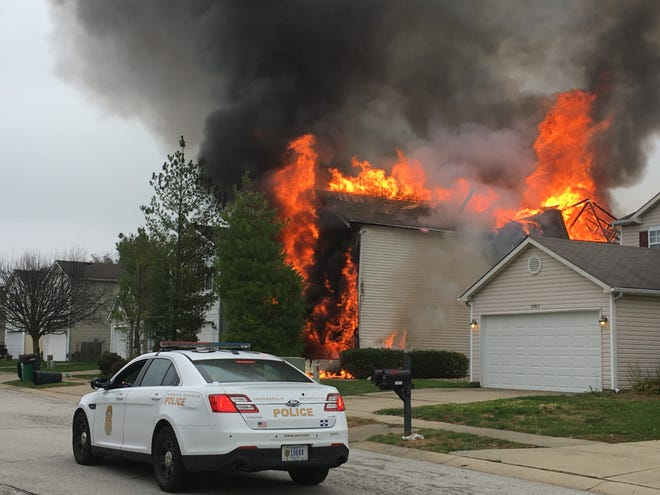 A house in Camby, Ind. is up in flames before it was destroyed in November 2017 when a gas pipeline was struck, causing an explosion.