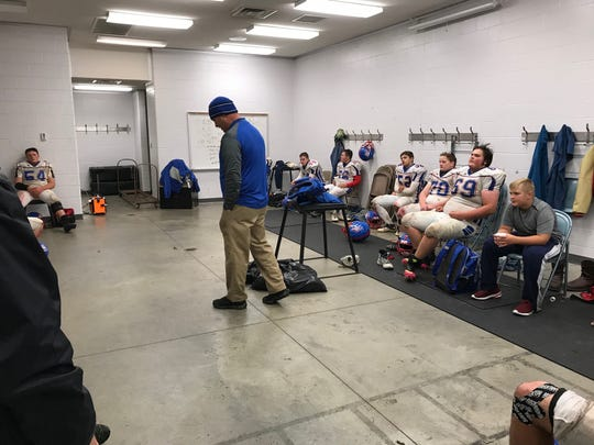 Coach Tony Slocum addresses the Caston team after last Friday's loss to Knox.