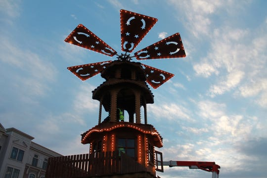 A 33-foot German-built Glühwein Pyramid, a traditional German Christmas decoration often featured at the markets in Germany, is assembled Oct. 15, 2018 in Carmel for the 2018 Christkindlmarkt.