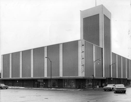A modernized downtown Sears store included an aqua colored aluminium exterior in 1964.