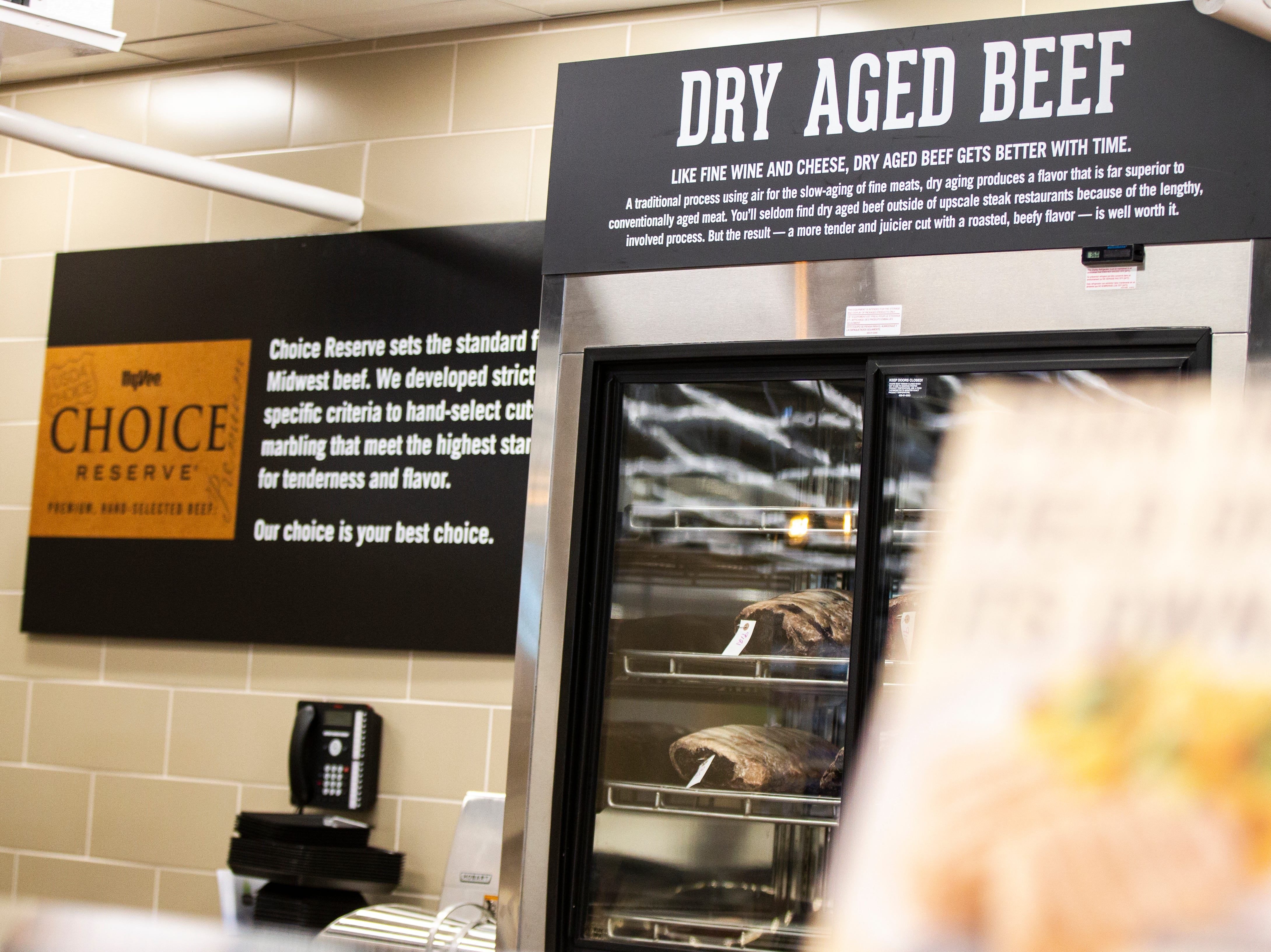 A beef is dry aged behind the counter in the meat department at a new Hy-Vee on Monday, Oct. 15, 2018, along Crosspark Road in Coralville, Iowa.