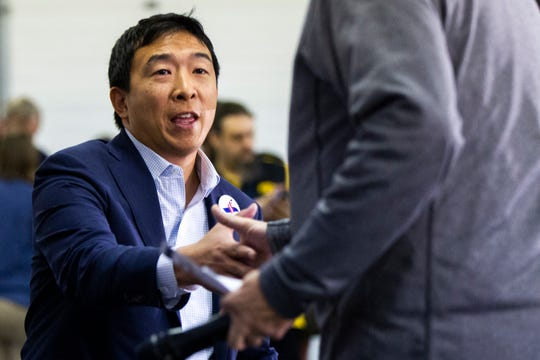 Andrew Yang, 2020 Democratic presidential candidate from Schenectady, New York, takes the stage during the Johnson County Democrats annual barbecue fundraiser on Sunday, Oct. 14, 2018, inside Building C at the Johnson County Fairgrounds in Iowa City.