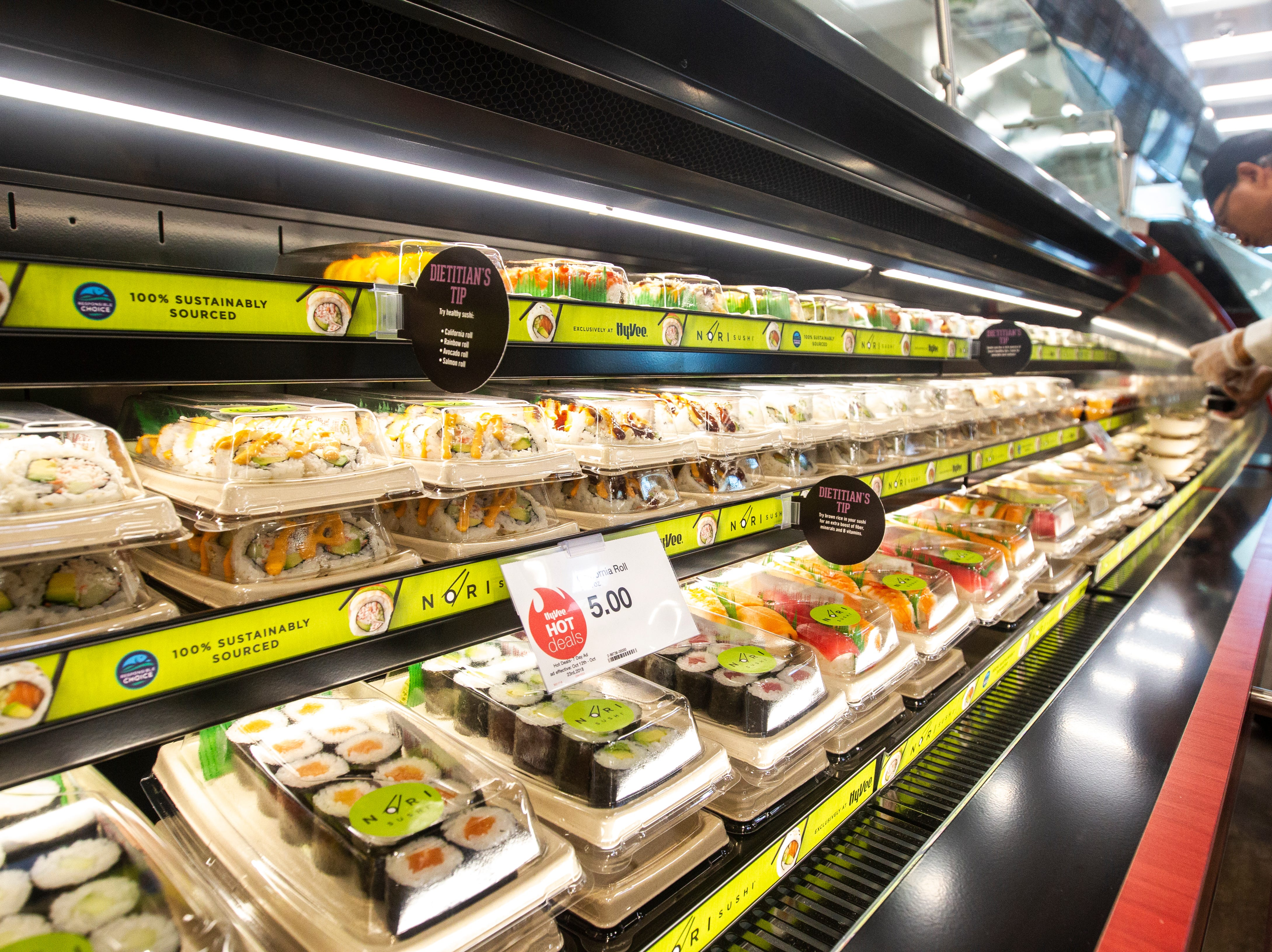 A chilled display case gets stocked with asian food at a new Hy-Vee on Monday, Oct. 15, 2018, along Crosspark Road in Coralville, Iowa.