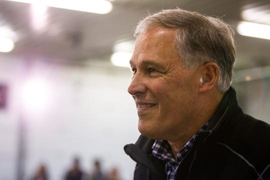 Washington Gov. Jay Inslee walks to the stage during the Johnson County Democrats annual barbecue fundraiser on Sunday, Oct. 14, 2018, inside Building C at the Johnson County Fairgrounds in Iowa City.