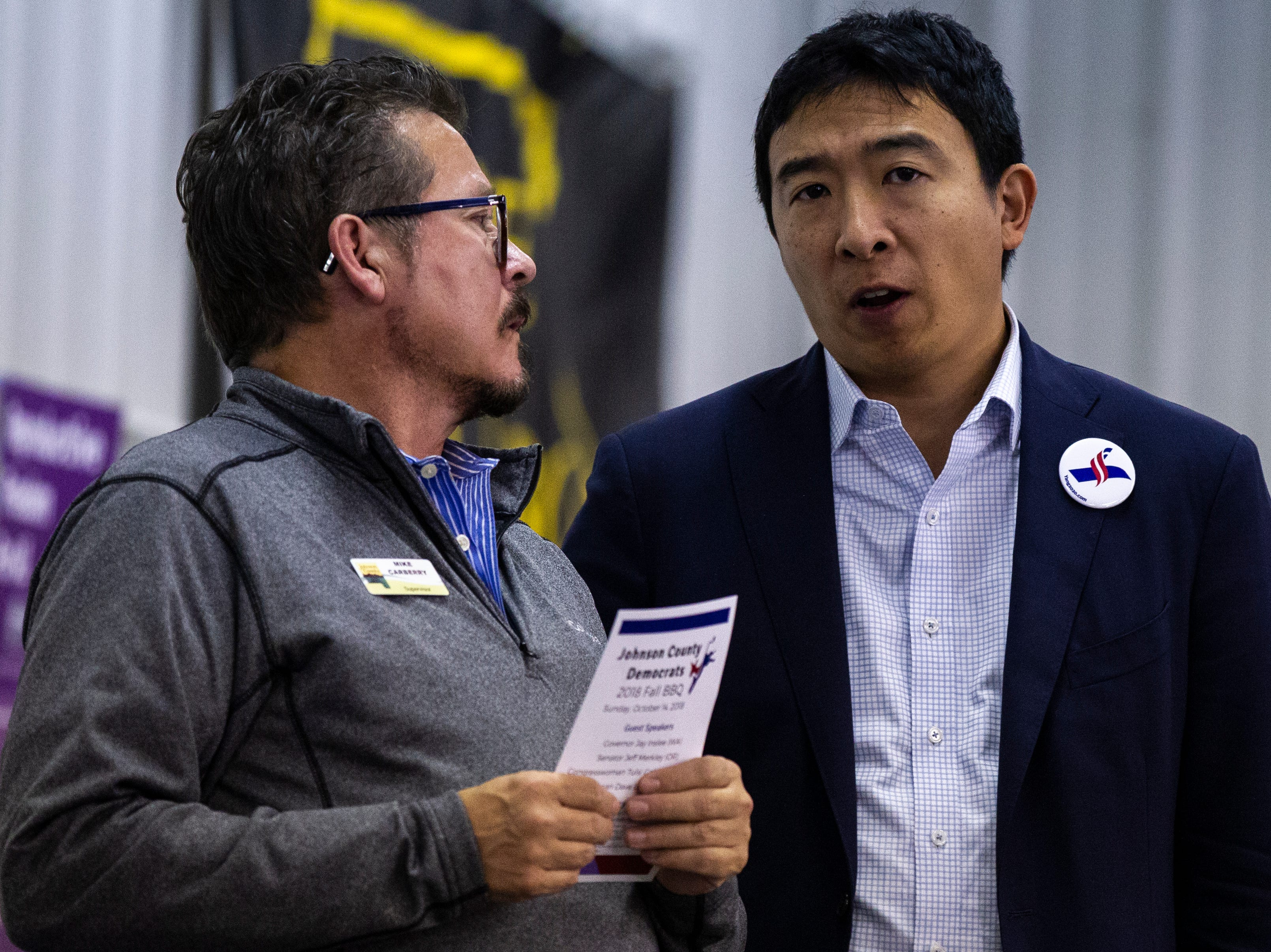 Johnson County Supervisor Mike Carberry talks with Andrew Yang, 2020 Democratic presidential candidate from Schenectady, New York, during the Johnson County Democrats annual barbecue fundraiser on Sunday, Oct. 14, 2018, inside Building C at the Johnson County Fairgrounds in Iowa City.