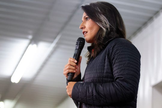 Rep. Tulsi Gabbard, D-Hawaii, speaks during the Johnson County Democrats annual barbecue fundraiser on Sunday, Oct. 14, 2018, inside Building C at the Johnson County Fairgrounds in Iowa City.