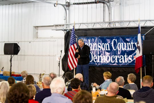 Washington Gov. Jay Inslee speaks during the Johnson County Democrats annual barbecue fundraiser on Sunday, Oct. 14, 2018, inside Building C at the Johnson County Fairgrounds in Iowa City.