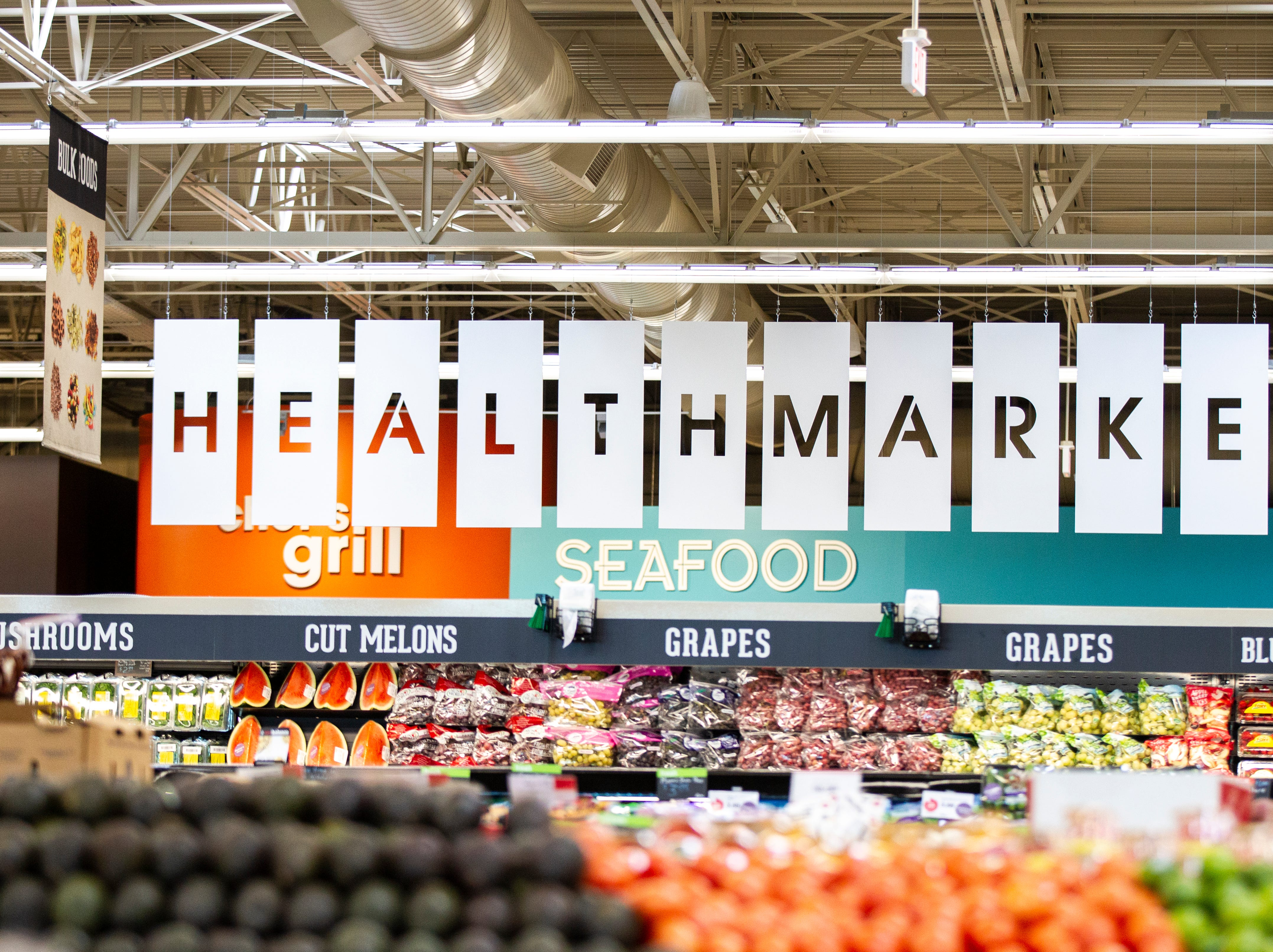 "A sign reading ""health market"" hangs at a new Hy-Vee on Monday, Oct. 15, 2018, along Crosspark Road in Coralville, Iowa."