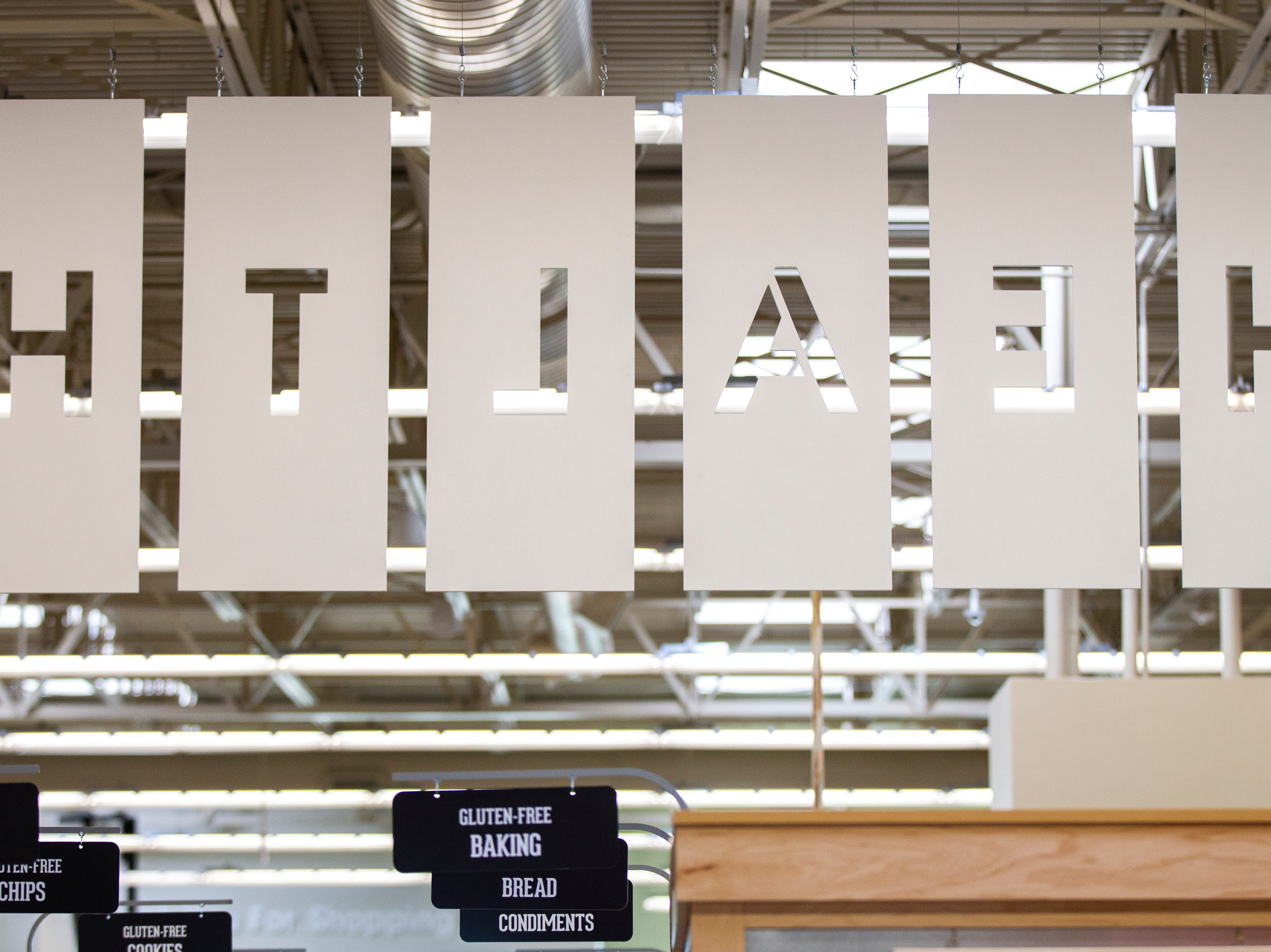 "A ""health market"" sign is seen from behind at a new Hy-Vee on Monday, Oct. 15, 2018, along Crosspark Road in Coralville, Iowa."