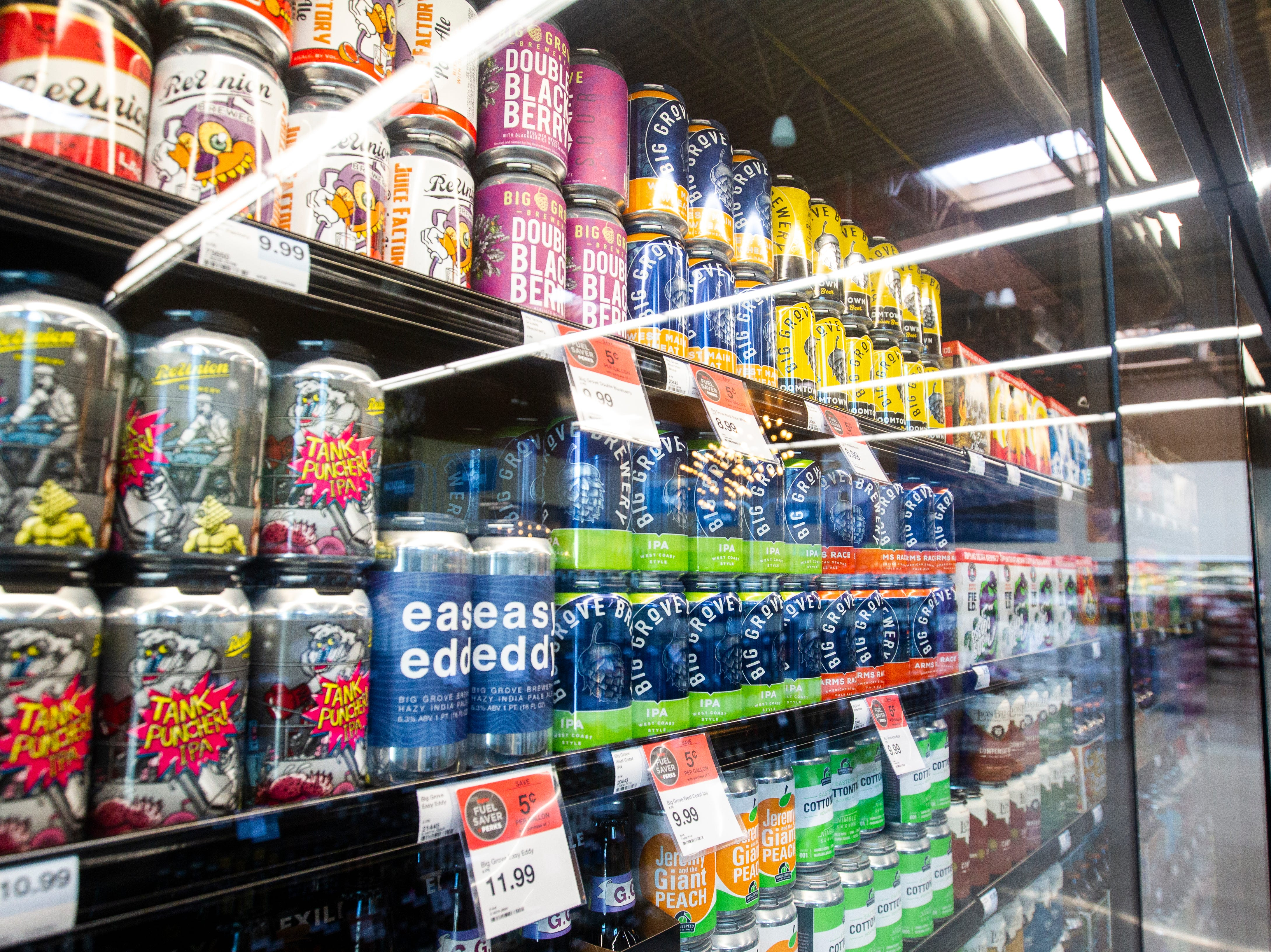 Big Grove Brewery cans are seen in a cooler at a new Hy-Vee on Monday, Oct. 15, 2018, along Crosspark Road in Coralville, Iowa.