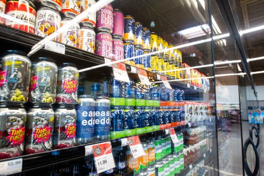 Big Grove Brewery and ReUnion Brewery cans are seen in a cooler at a new Hy-Vee on Monday, Oct. 15, 2018, along Crosspark Road in Coralville, Iowa.