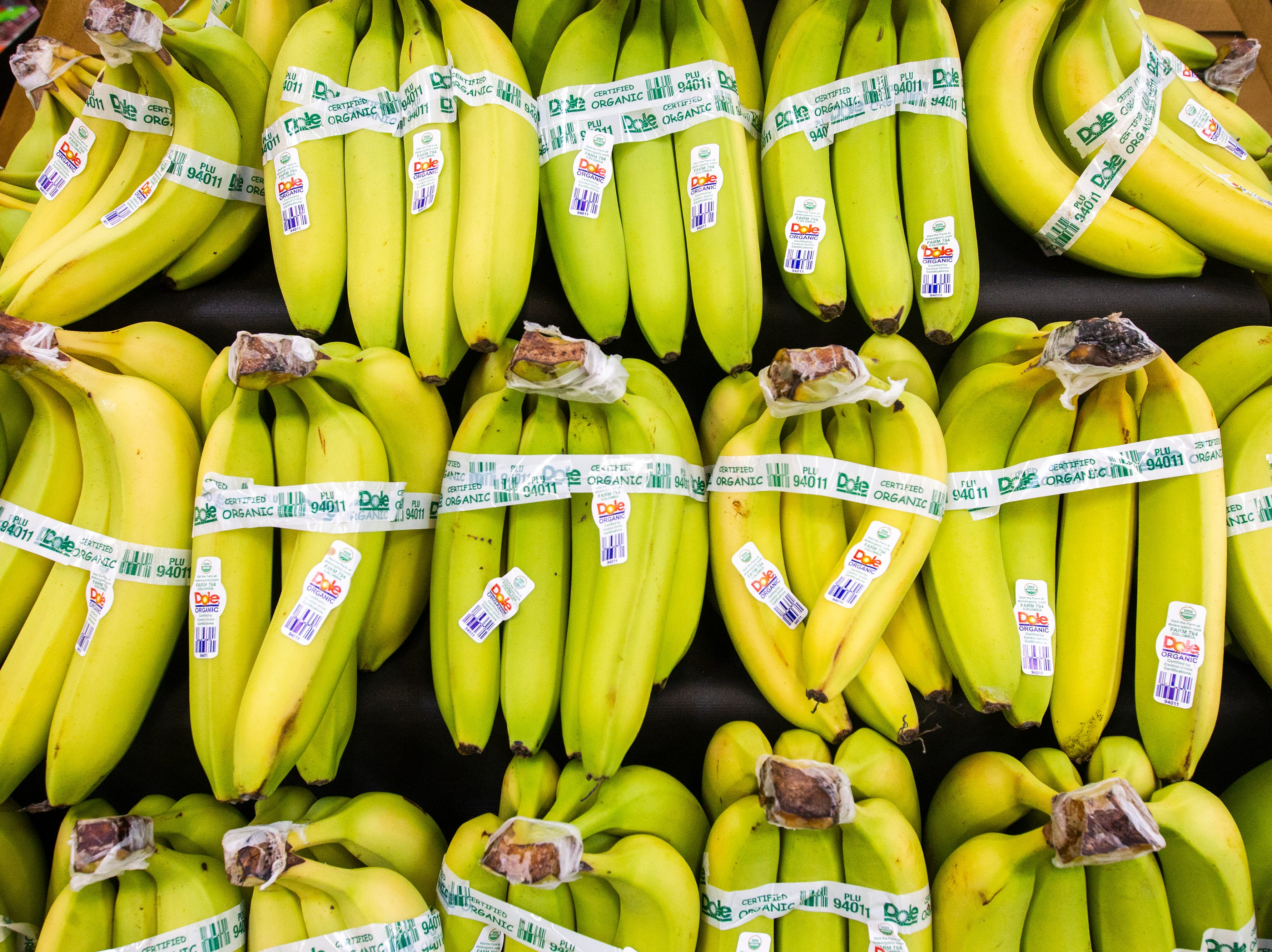Organic bananas are displayed at a new Hy-Vee on Monday, Oct. 15, 2018, along Crosspark Road in Coralville, Iowa.