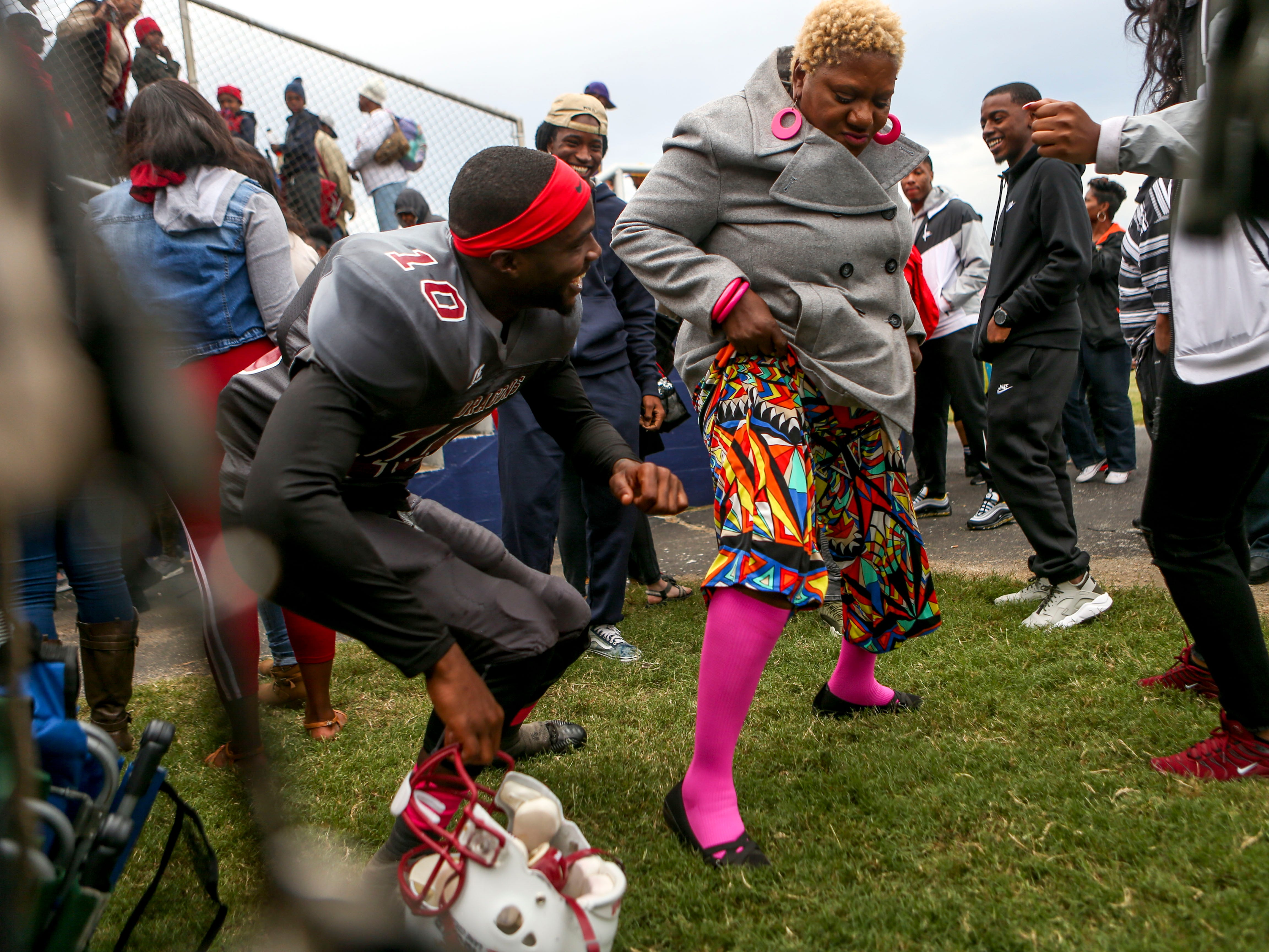 Rose Donahue, right, dances with her grandson Terrance Kinnie (10) after Lane College won their homecoming game at T.R. White Sportsplex in Jackson, Tenn., on Saturday, Oct. 13, 2018.