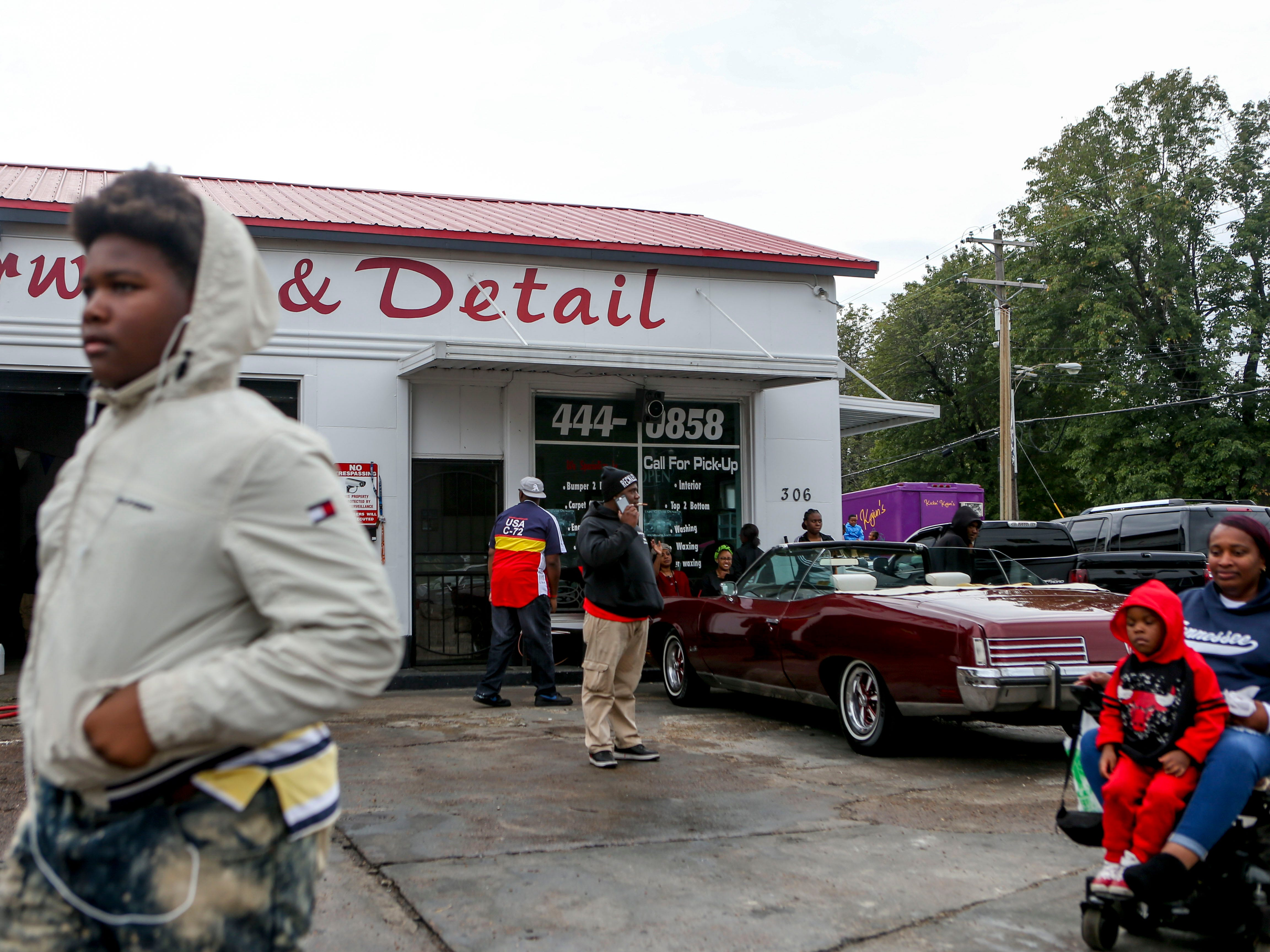 Residents walk past Corey's Carwash & Detail on homecoming weekend at T.R. White Sportsplex in Jackson, Tenn., on Saturday, Oct. 13, 2018.