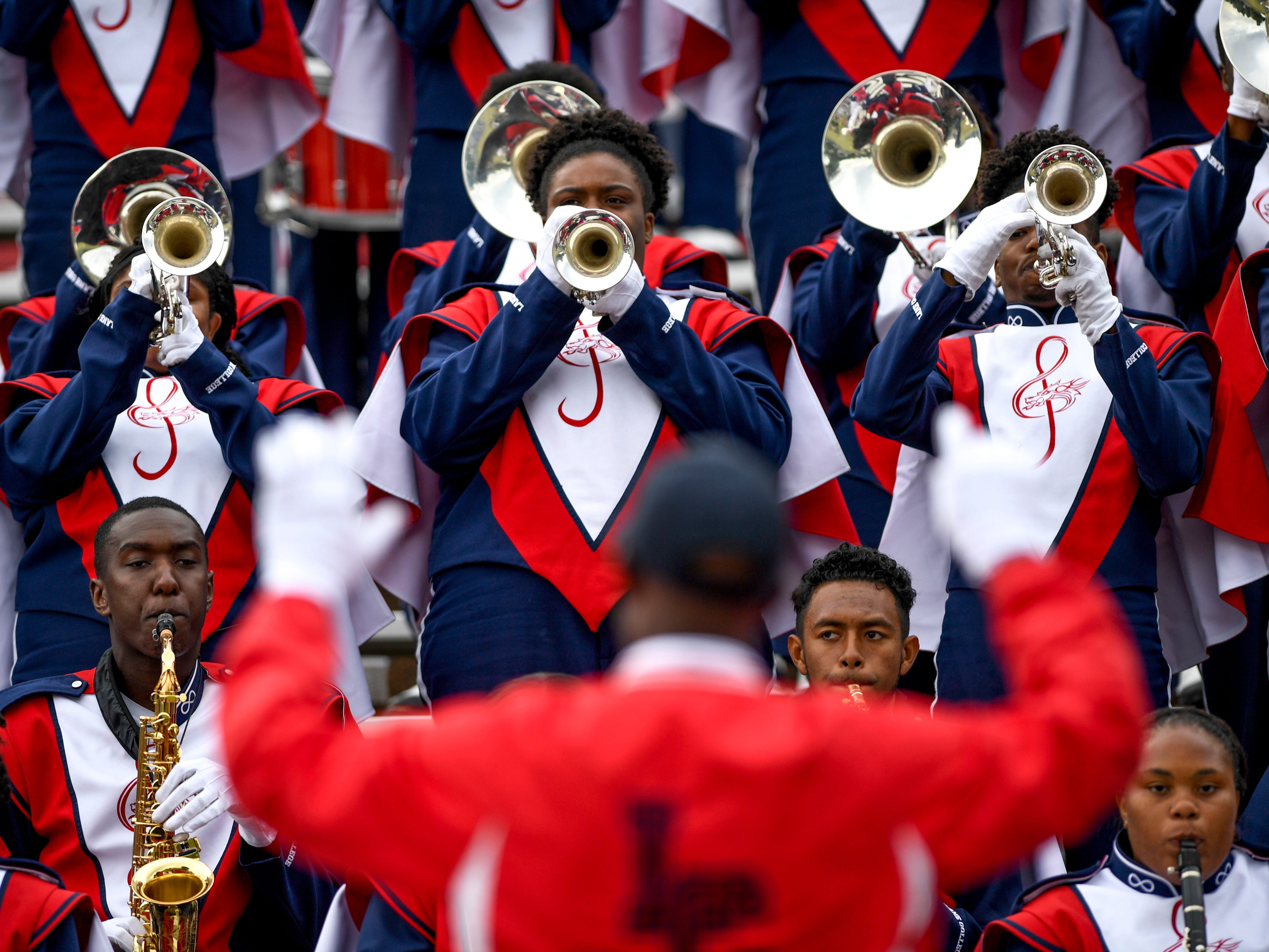 Lane College band members perform fight songs at the end of a game against Allen University at T.R. White Sportsplex in Jackson, Tenn., on Saturday, Oct. 13, 2018.