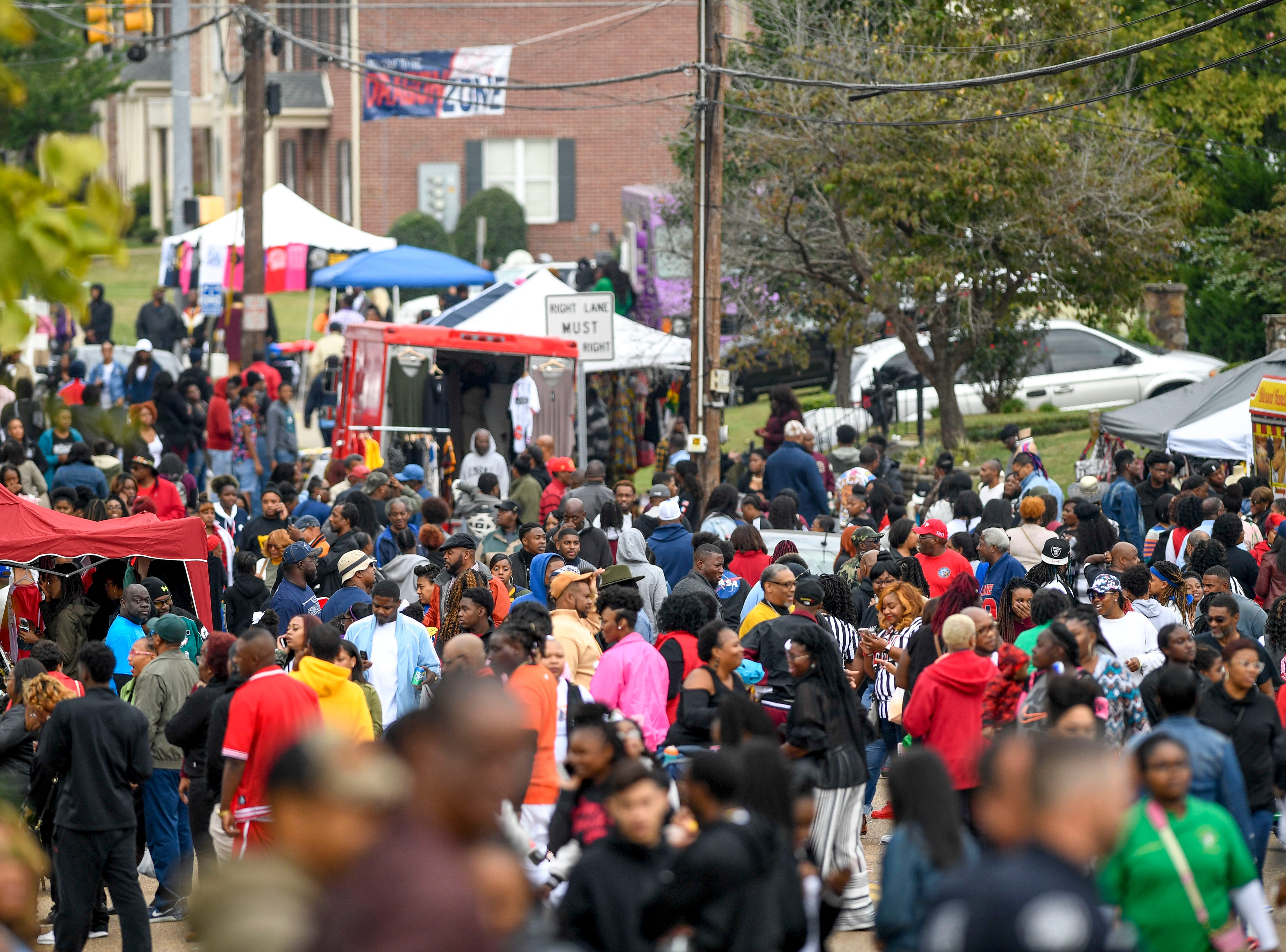 Crowds fill the street on Hayes Ave. for homecoming celebrations outside of T.R. White Sportsplex in Jackson, Tenn., on Saturday, Oct. 13, 2018.