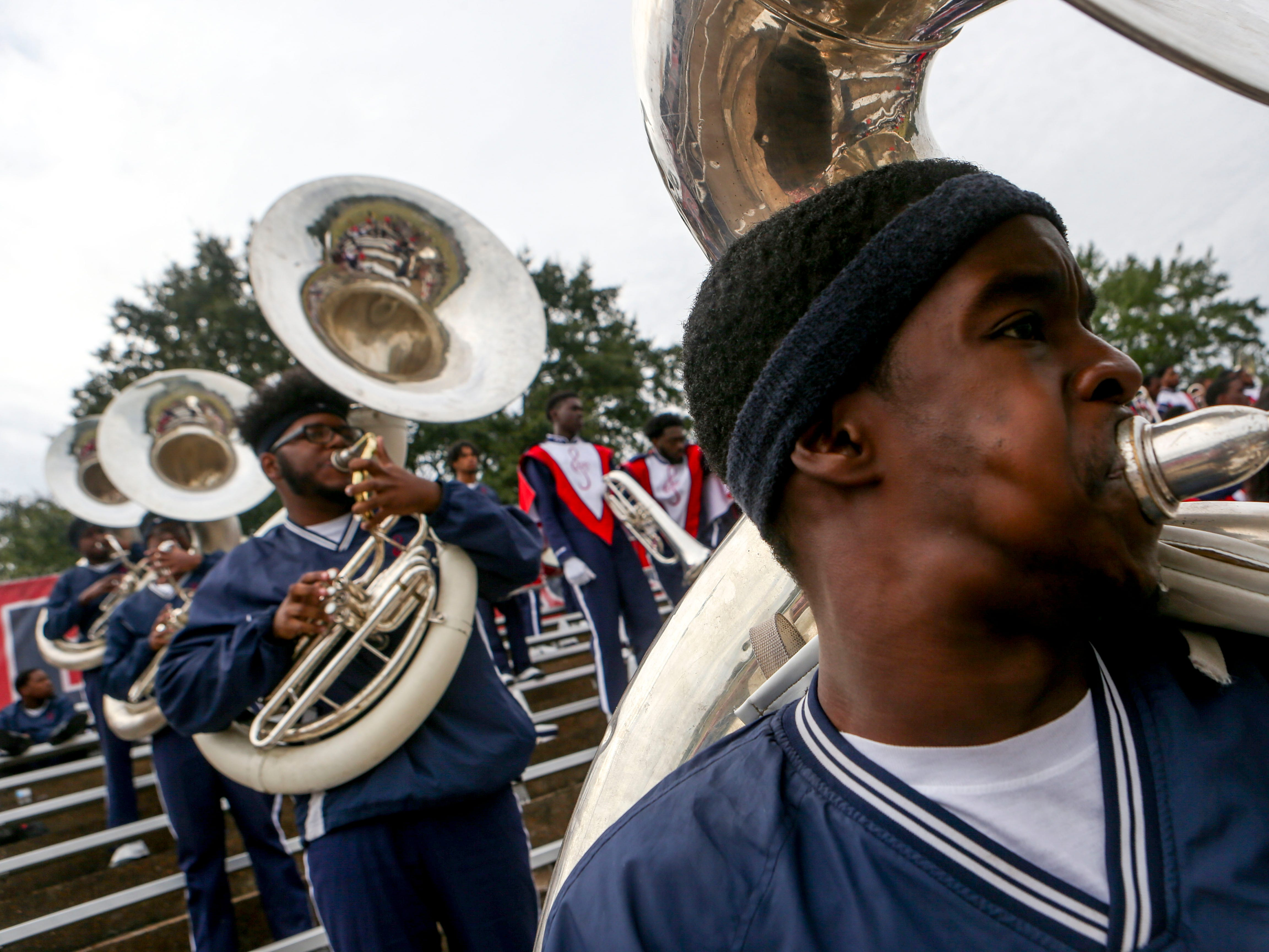 Ezell Miles plays the sousaphone during a fight song at T.R. White Sportsplex in Jackson, Tenn., on Saturday, Oct. 13, 2018.