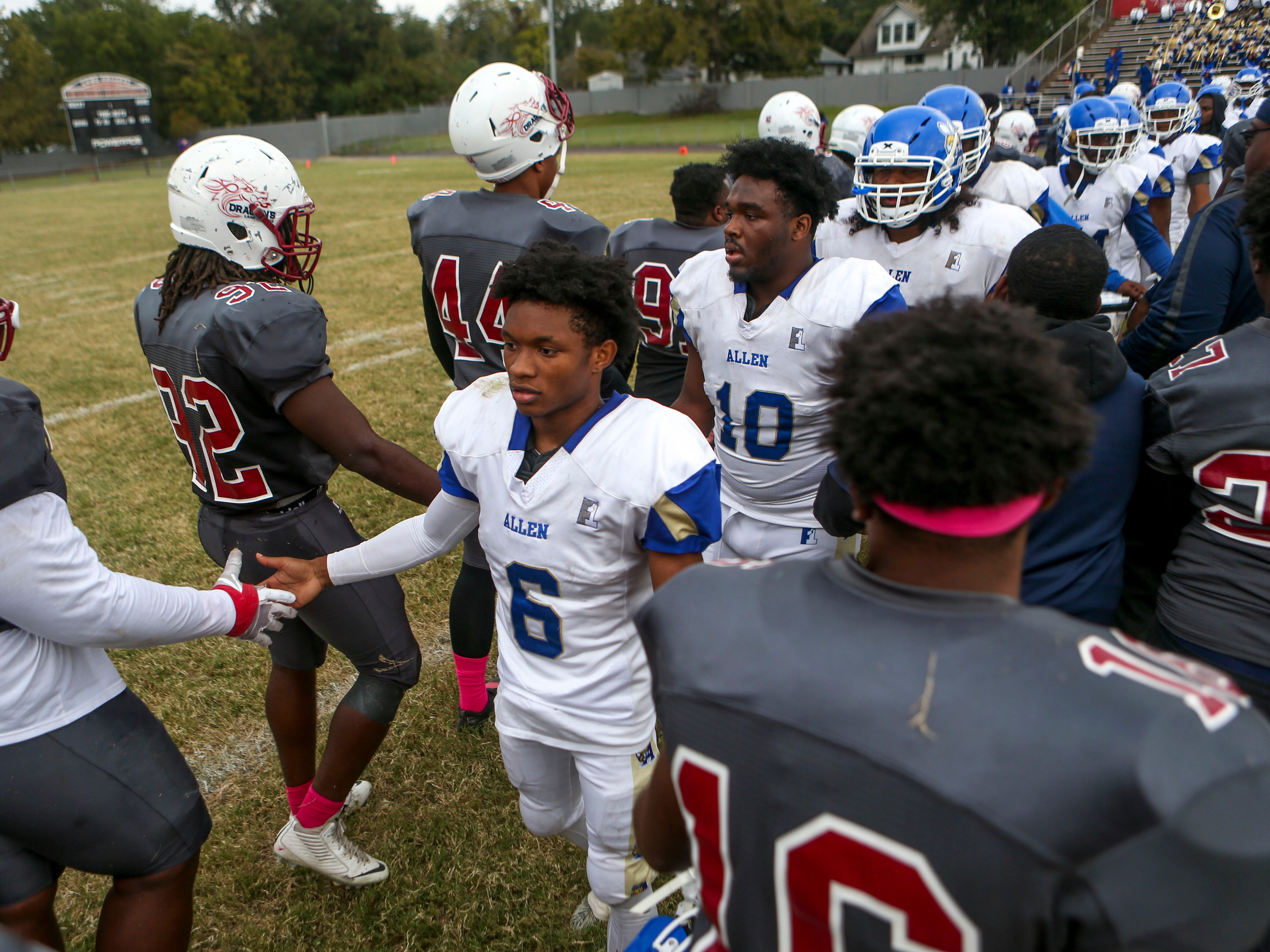 Lane College and Allen University players shake hands after the Lane homecoming game where Lane won 13-3 at T.R. White Sportsplex in Jackson, Tenn., on Saturday, Oct. 13, 2018.
