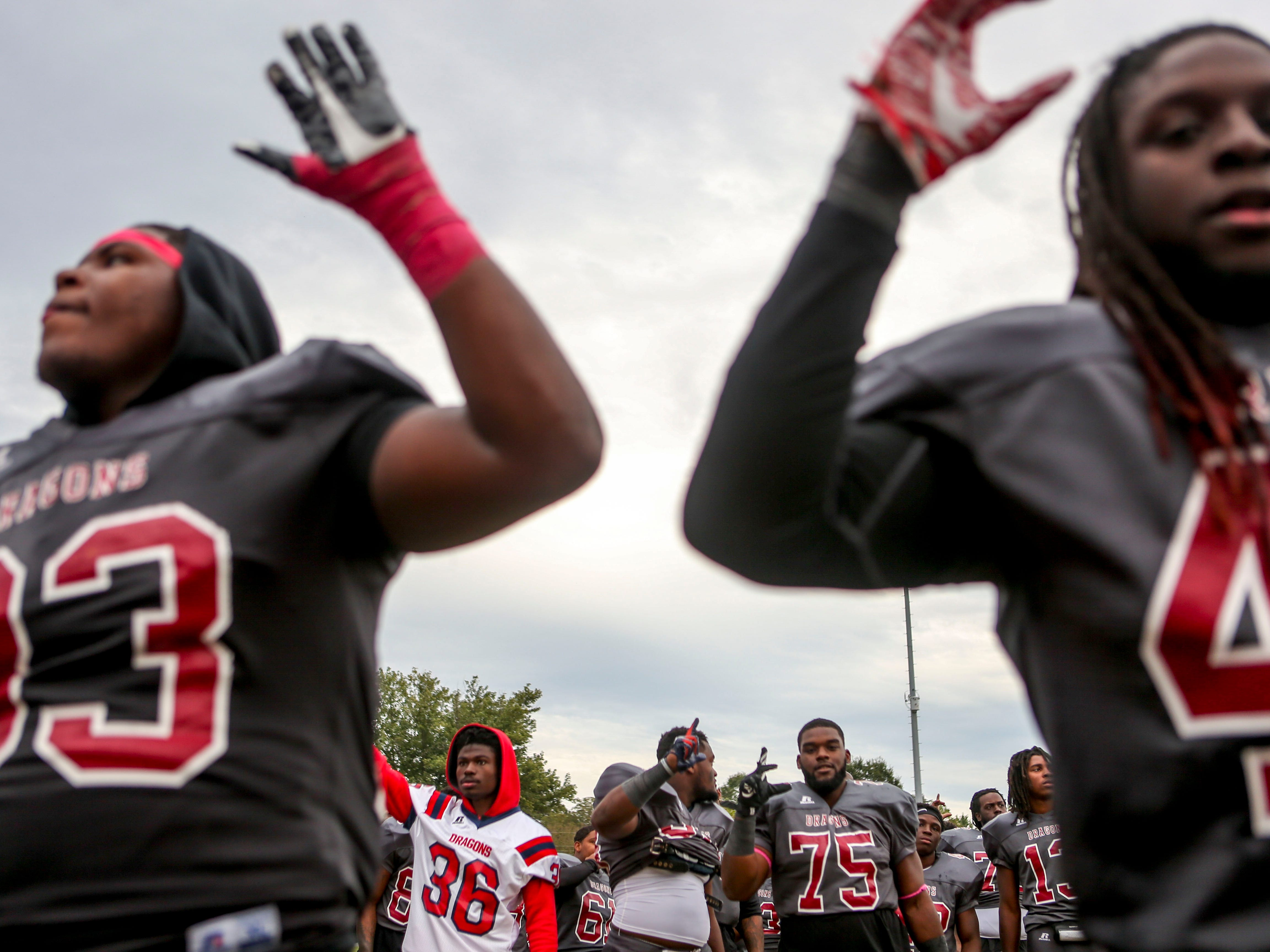 "Lane College players hold up their hand sin the ""LC"" formation after winning against Allen University at T.R. White Sportsplex in Jackson, Tenn., on Saturday, Oct. 13, 2018."