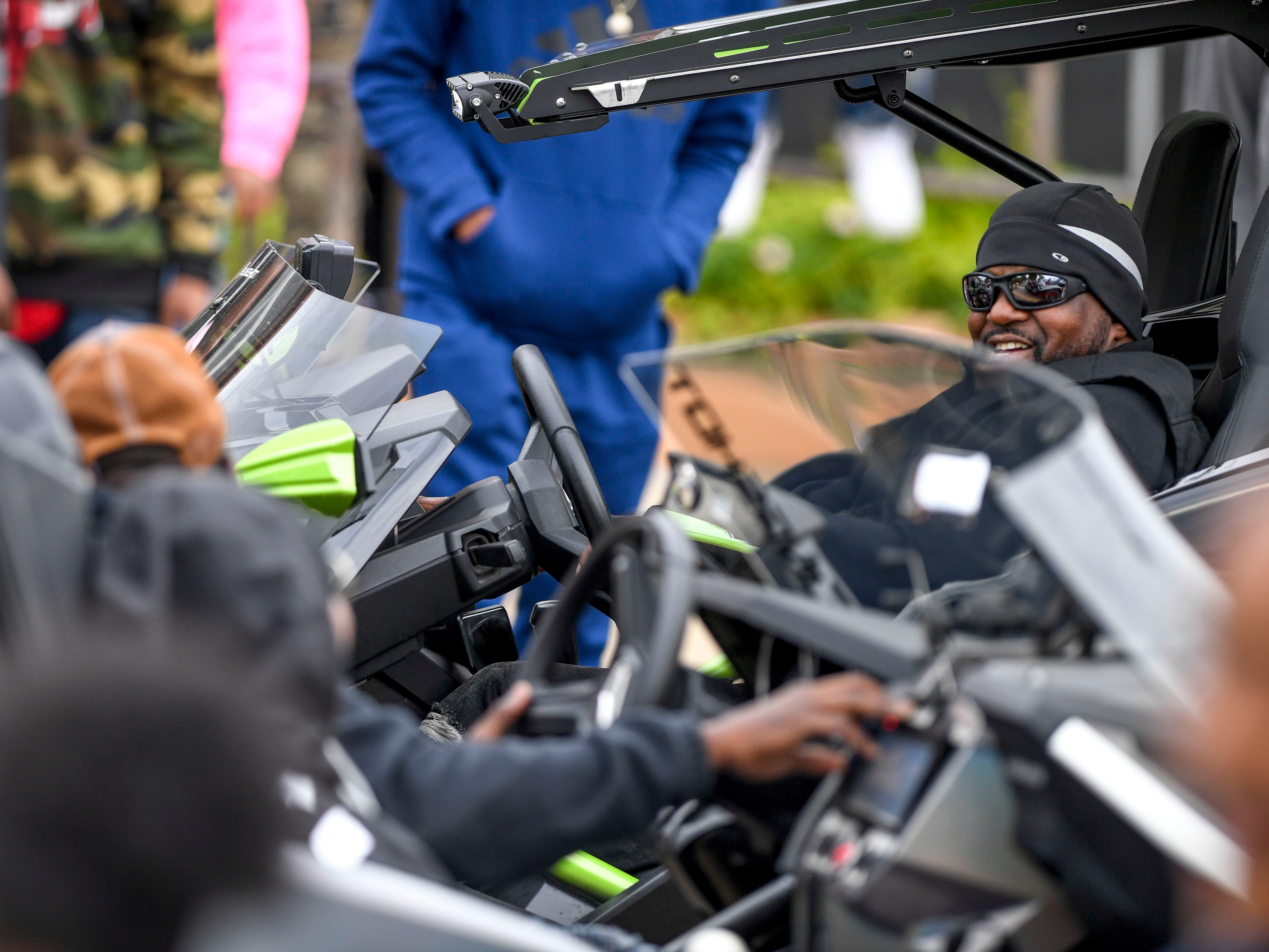 Polaris Slingshot drivers smile and chat as they pass one another at T.R. White Sportsplex in Jackson, Tenn., on Saturday, Oct. 13, 2018.