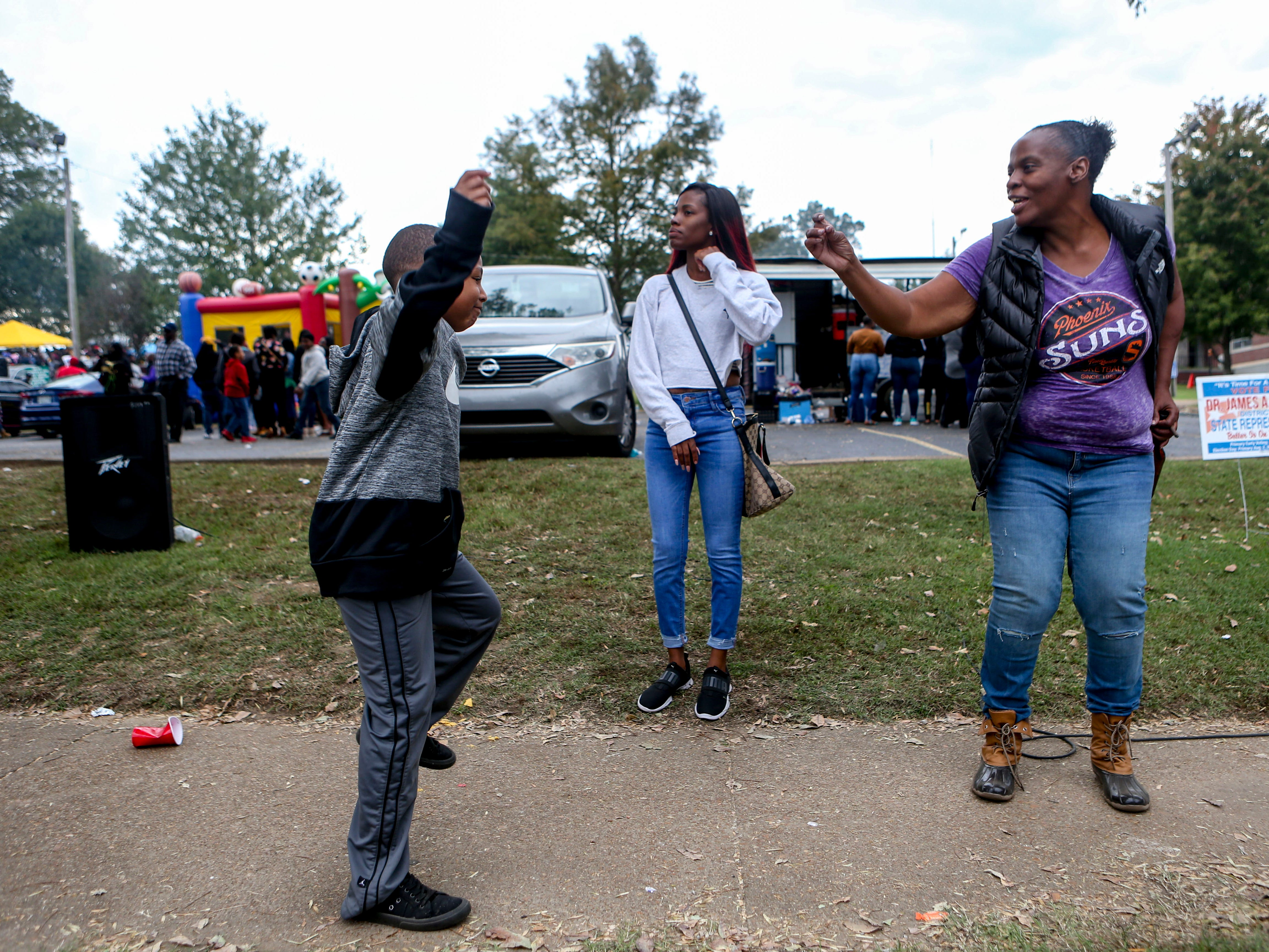 Terrion Yarbrough dances with his family on the sidewalk during Lane College's homecoming at T.R. White Sportsplex in Jackson, Tenn., on Saturday, Oct. 13, 2018.