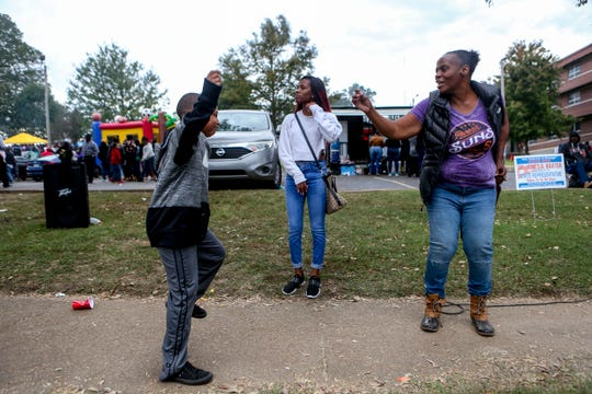 Terrion Yarbrough dances with his family on the sidewalk during Lane College's homecoming at T.R. White Sportsplex in Jackson, Tenn., on Oct. 13, 2018.