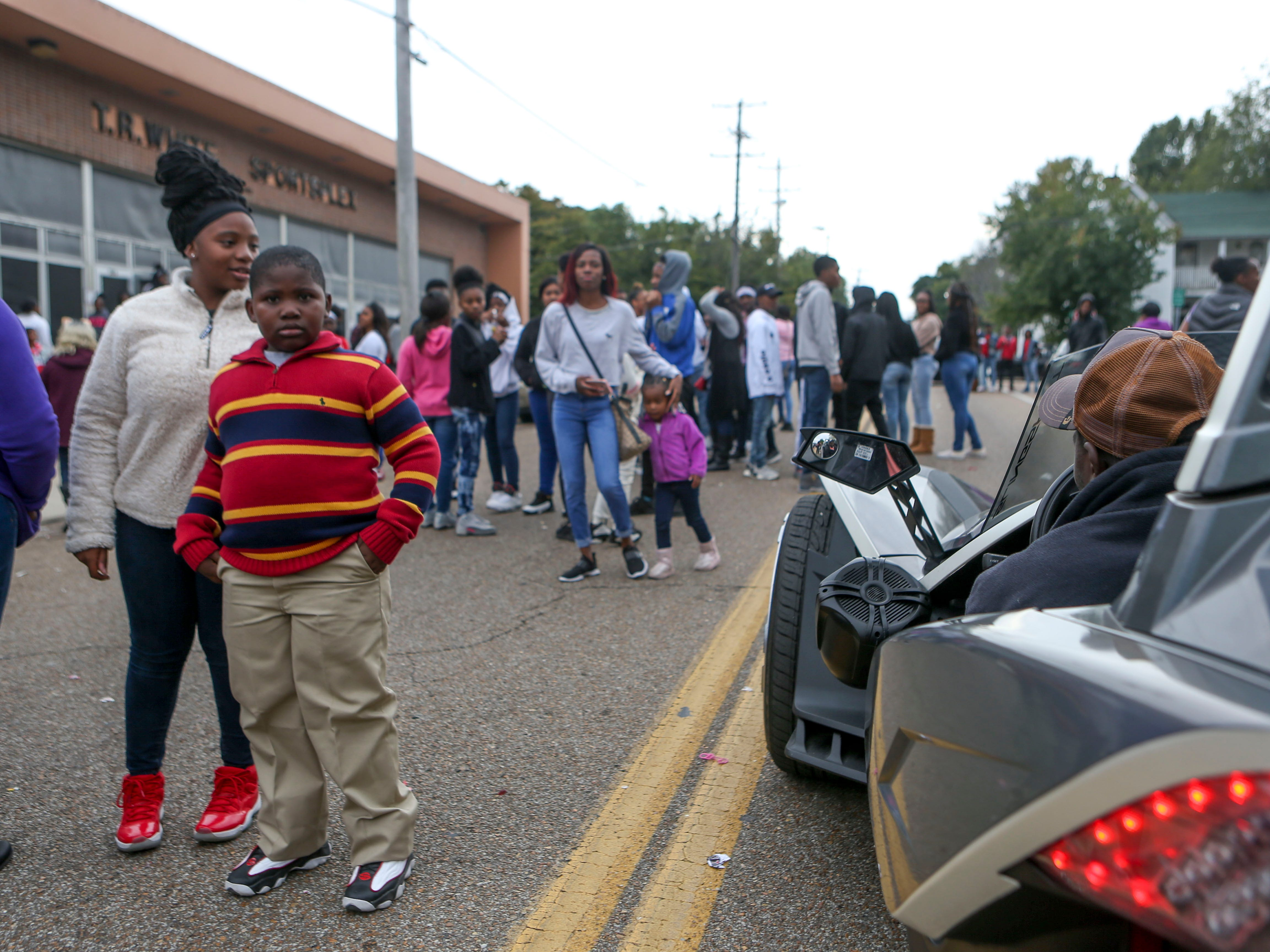 Folks hang out on Hayes Avenue and watch tricked out vehicles drive by at T.R. White Sportsplex in Jackson, Tenn., on Saturday, Oct. 13, 2018.