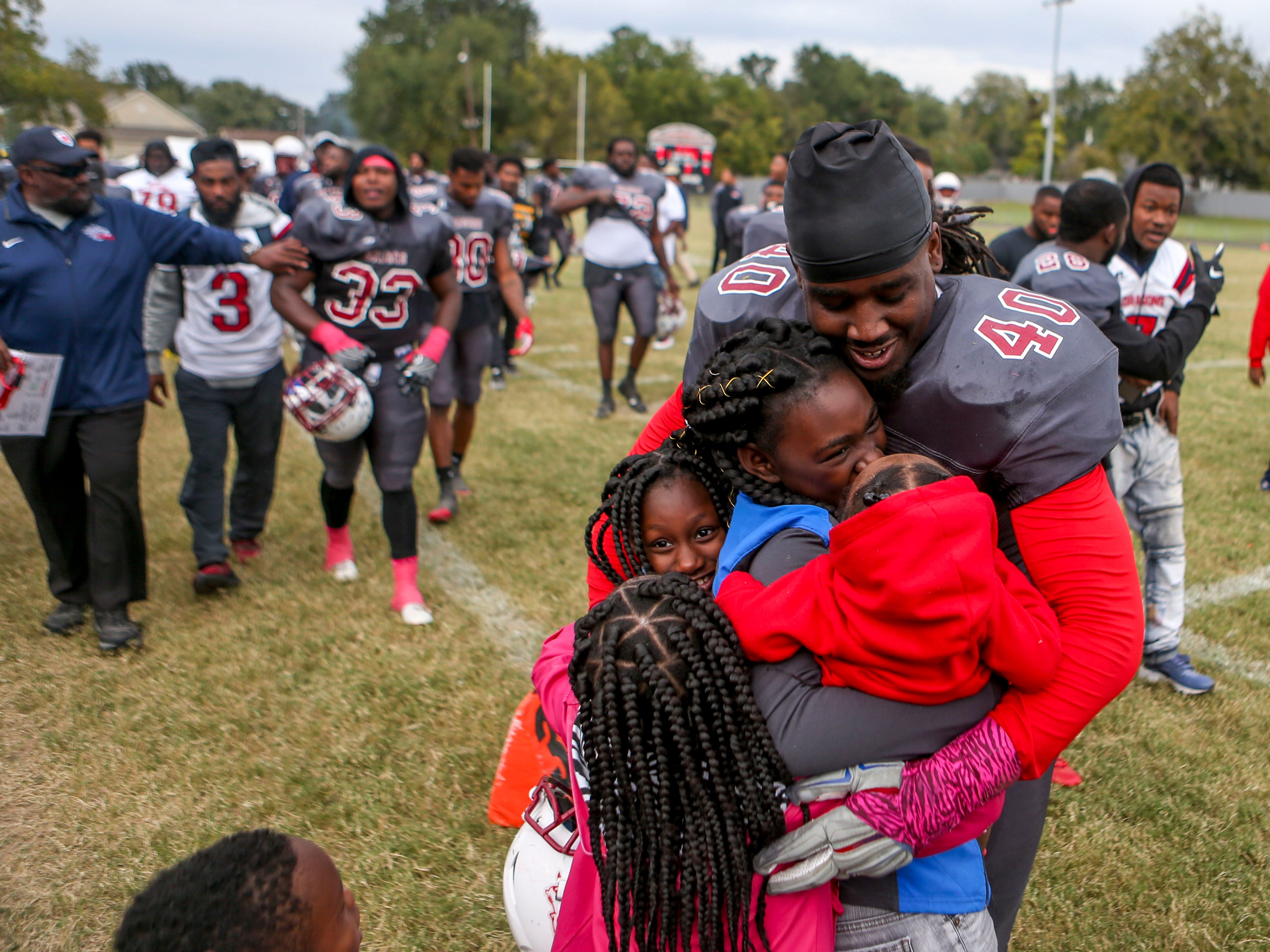Johnny Russell Jr (40) embraces his kids and family coming off the field after Lane College won their homecoming game at T.R. White Sportsplex in Jackson, Tenn., on Saturday, Oct. 13, 2018.