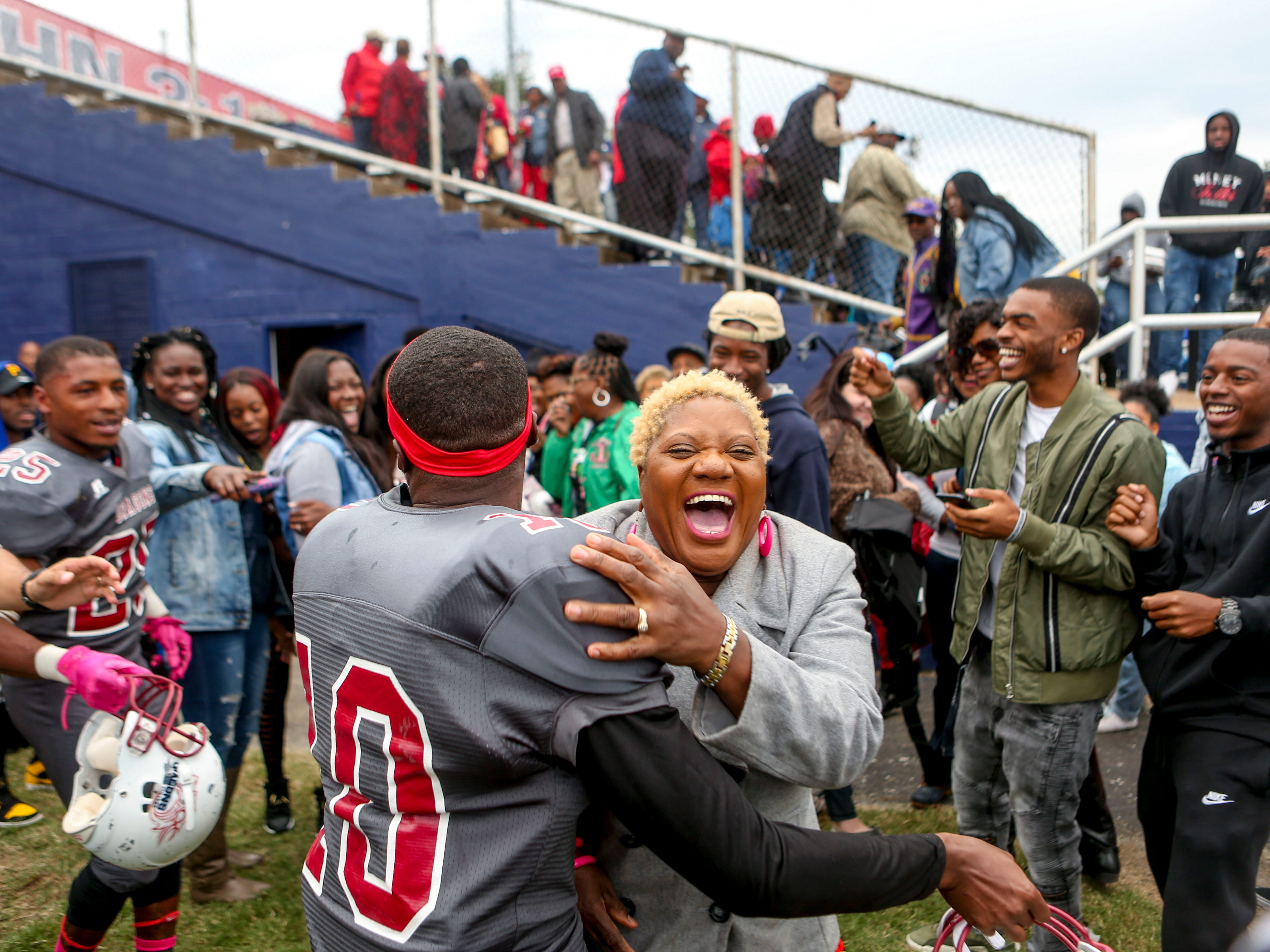 Rose Donahue erupts in laughter with her grandson Terrance Kinnie (10) after dancing to celebrate Lane College winning their homecoming game against Allen University at T.R. White Sportsplex in Jackson, Tenn., on Saturday, Oct. 13, 2018.