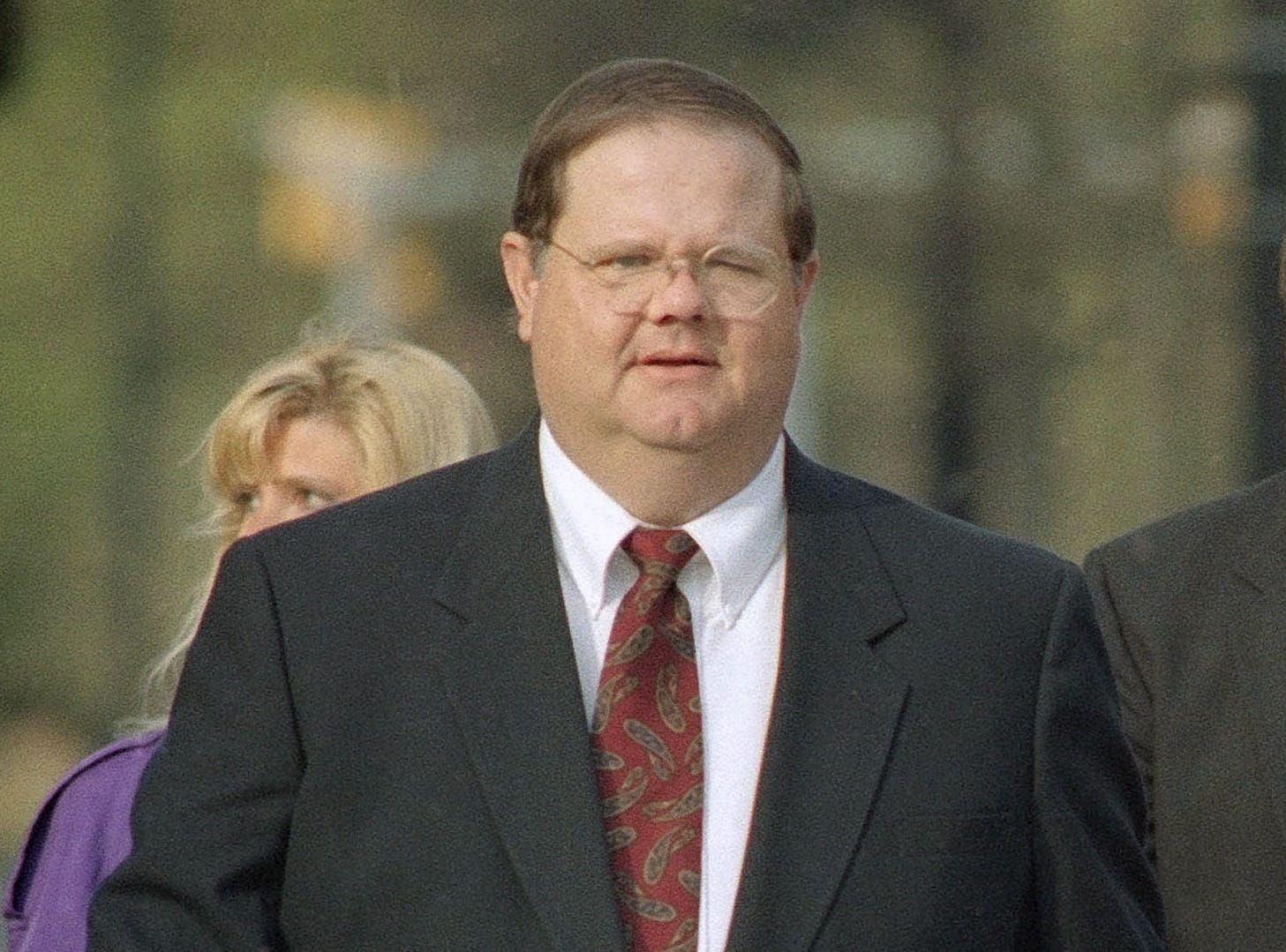 FILE -  This March 31, 1995 file photo shows former Knox County medical examiner Dr. Randall Pedigo walking to a court appearance in Knoxville, Tenn. Pedigo pleaded guilty to drugging and molesting young males. Tennessee has a storied history with some of its top death investigators. (Knoxville News Sentinel, J. Miles Cary, File)