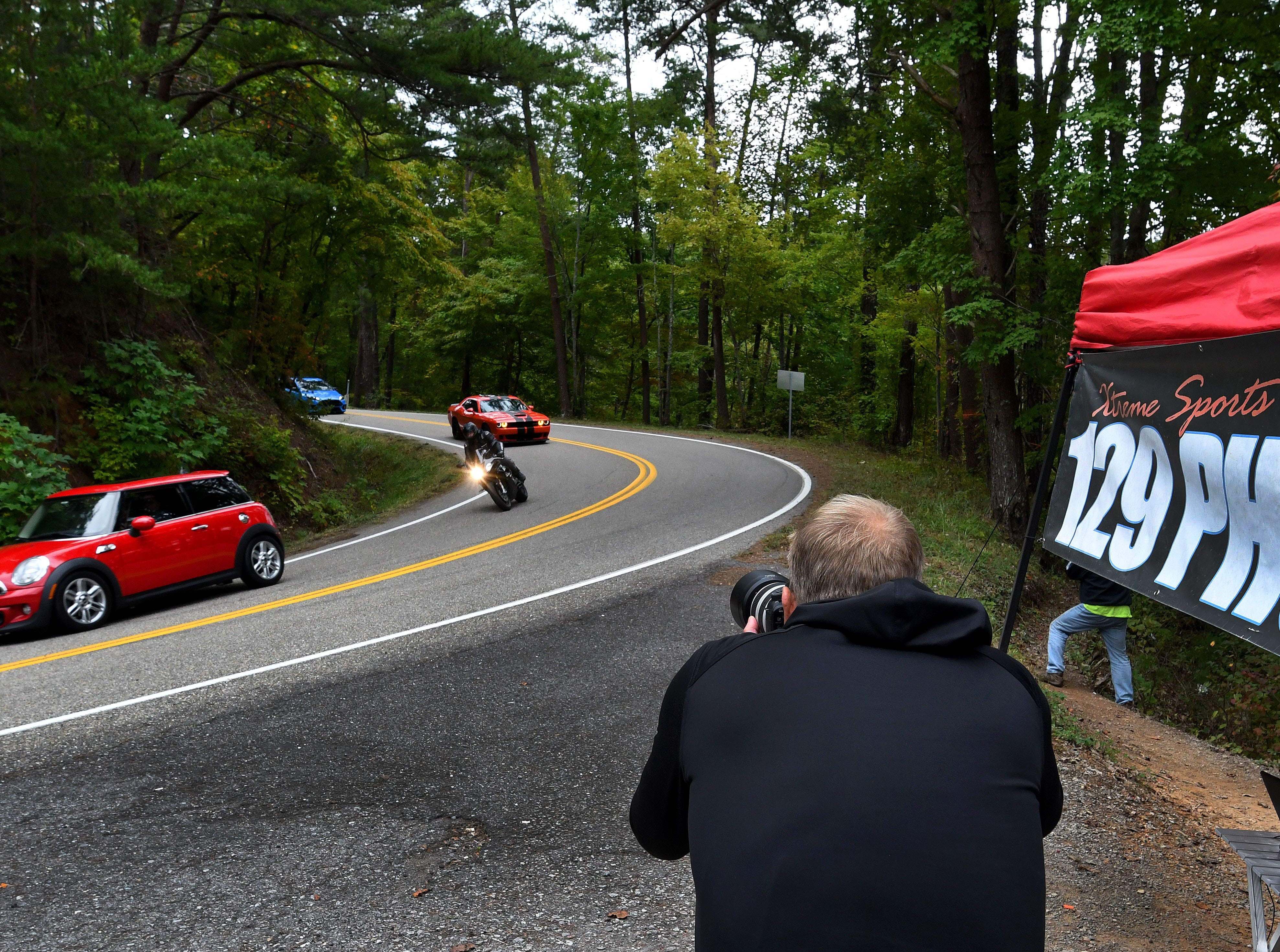 The Dragon is a section of US129 in Tennessee and North Carolina famous for it's 318 curves in 11 miles Saturday, Oct. 13, 2018. Kevin Netto is a photographer with Extreme Sports Photography and 129photos.com and is one of several companies shooting photos of vehicles traveling on the Dragon.