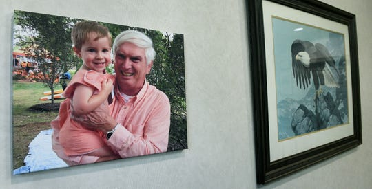 "Retiring Congressman John J. ""Jimmy"" Duncan's walls and table are filled with family photos."