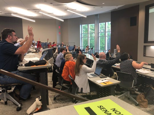 Members of the faculty senate voted to unanimously approve a resolution asking the Board of Trustees to reconsider the post-tenure review policy that was passed in March.