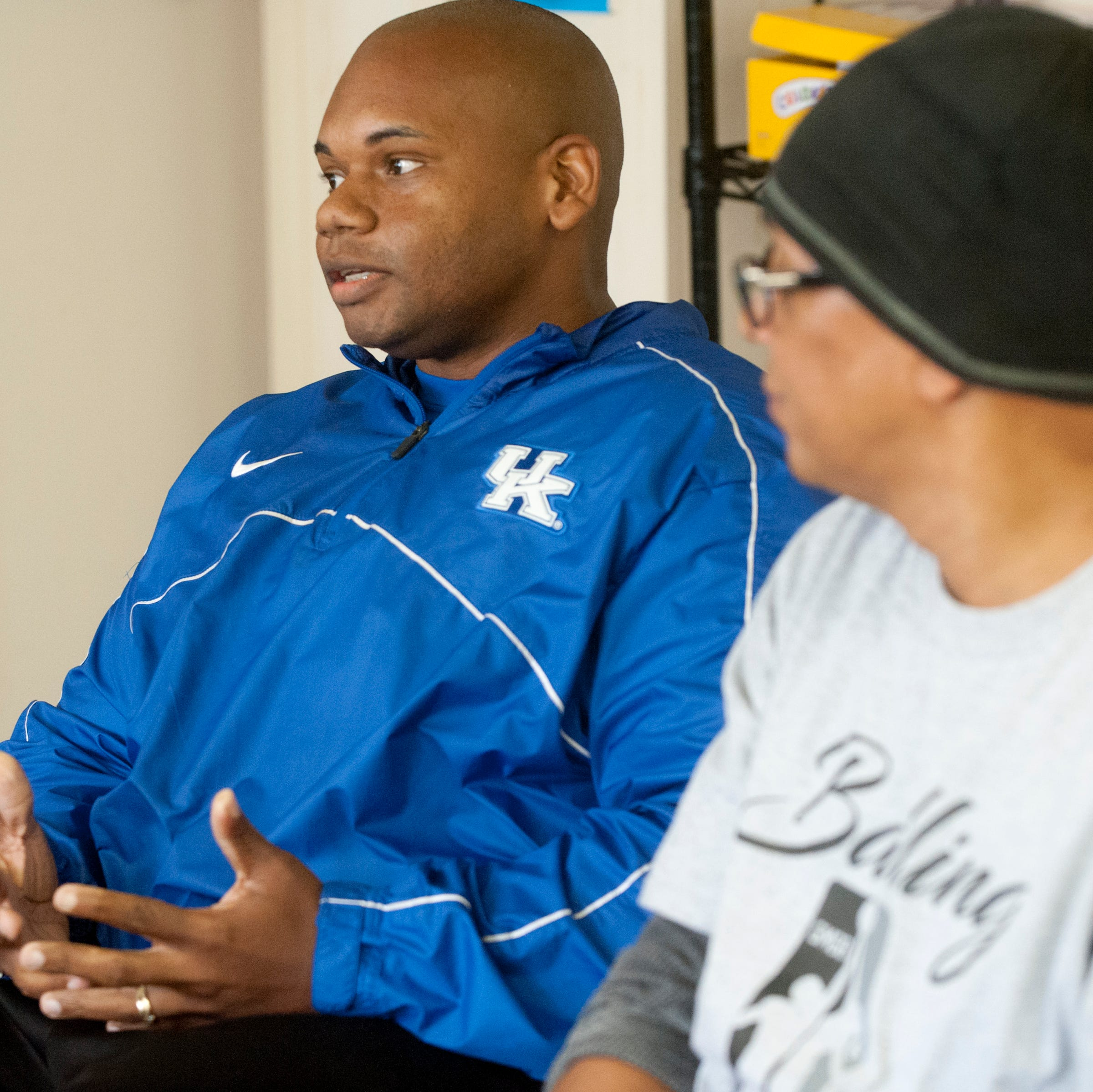 Kentucky Commissioner of Education Wayne Lewis chats with Balling for a Cause members at the Chestnut Street YMCA as the basketball group's spokesman, Christopher 2X looks on..October 13, 2018
