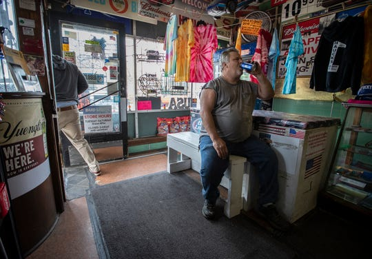 Billy Compton, 54, enjoyed a beer after cutting the grass at Hauck's Handy Store in the Schnitzelberg neighborhood. The store which has been in business since 1912 is for sale. Compton serves as the store's handyman. Oct. 12, 2018.