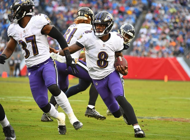Oct 14, 2018; Nashville, TN, USA; Baltimore Ravens quarterback Lamar Jackson (8) runs for a first down during the second half against the Tennessee Titans at Nissan Stadium. Mandatory Credit: Christopher Hanewinckel-USA TODAY Sports