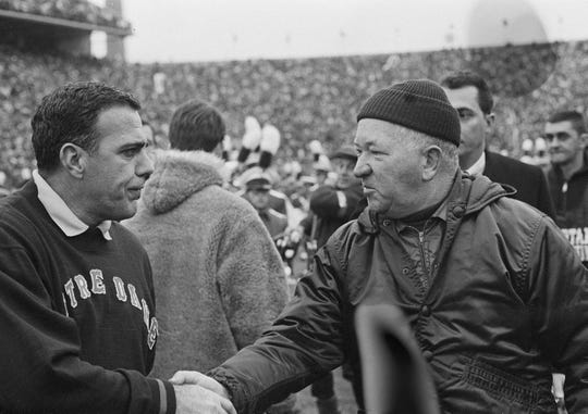 Notre Dame football coach Ara Parseghian, left, shakes hands with MSU coach Duffy Daugherty after their 10-10 tie in East Lansing, November 1966.  The game is considered one of the most famous games in college football history.