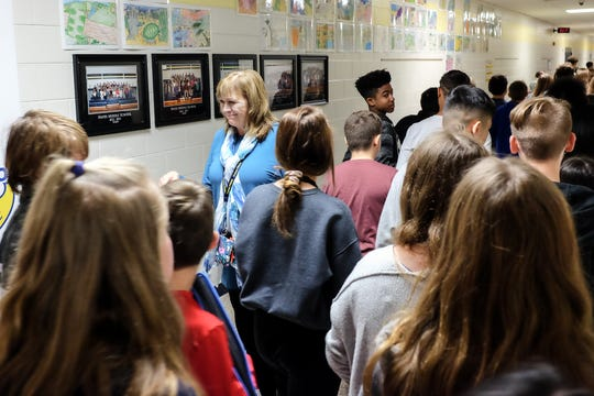 Julie Taylor, principal at Hayes Middle School in Grand Ledge, walks the halls during lunch to keep order Monday, Oct. 15, 2018.