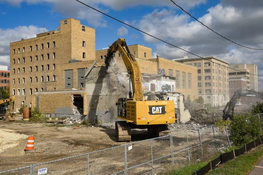 Demolition on the south side of the downtown YMCA is underway, Monday, Oct. 15, 2018.