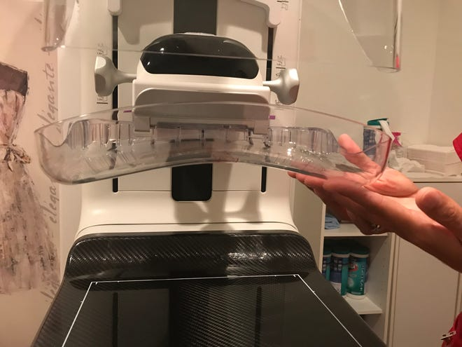The new look of the mammogram machine at Capital Internal Medicine Associates in Haslett as shown Oct. 4, 2018. Mammographer Jessica Gray hows the curved plate that's designed to reduce discomfort during breast