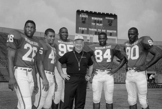 Duffy Daugherty with 1966 All-Americans. Left to right: Running Back Clinton Jones, Fullback Bob Apisa, Defensive End Bubba Smith, Pass Receiver Gene Washington, and Rover Back George Webster.